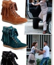 A bota com franjas de Débora em Avenida Brasil